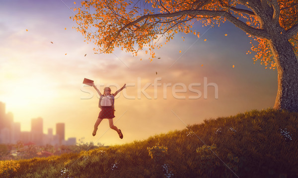 child jumping with book Stock photo © choreograph