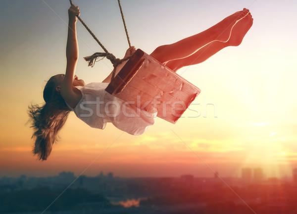ребенка девушки Swing счастливым смеясь закат Сток-фото © choreograph