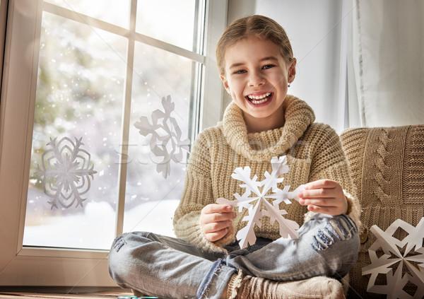 Gyermek papír hópelyhek aranyos kislány ül Stock fotó © choreograph