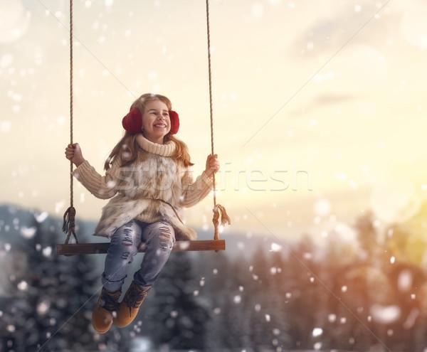 Ragazza swing tramonto inverno felice bambino Foto d'archivio © choreograph