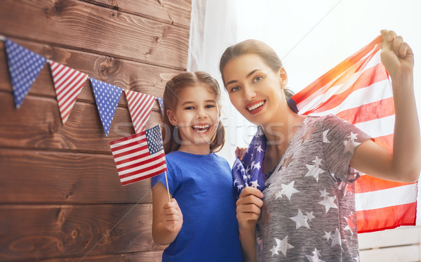 mother and girl with American flag Stock photo © choreograph