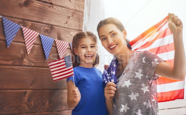 Anya lány amerikai zászló hazafias ünnep boldog család Stock fotó © choreograph