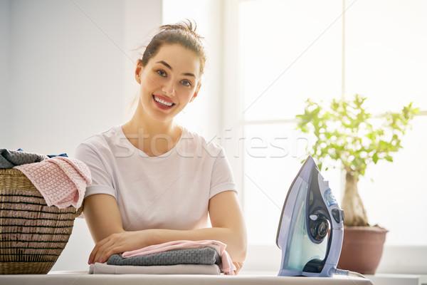woman is ironing at home Stock photo © choreograph