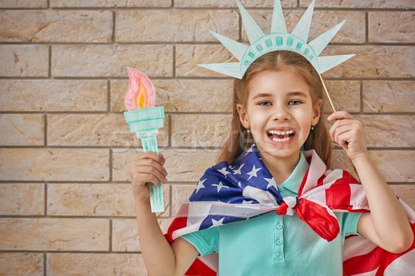 girl with American flag Stock photo © choreograph