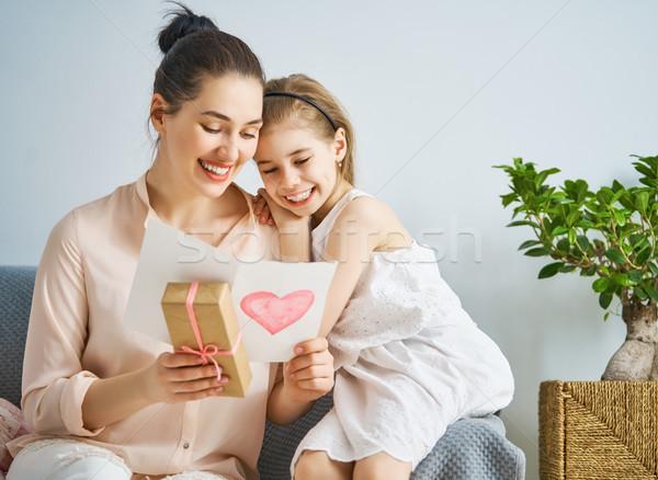 daughter is congratulating mom Stock photo © choreograph