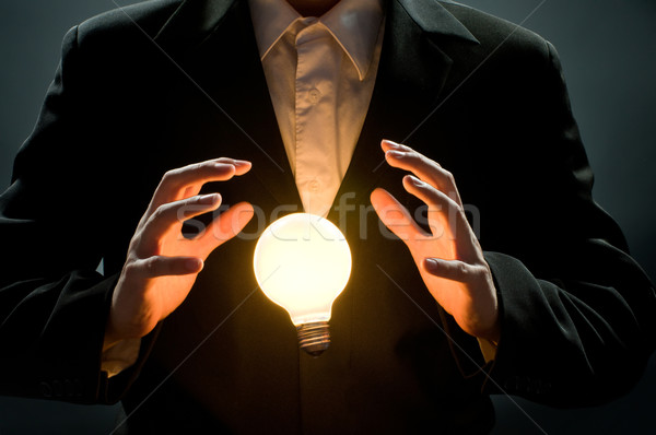 Verlicht lamp man wijzend business lamp Stockfoto © choreograph