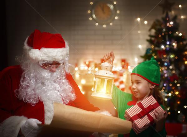 Kerstman elf lezing lijst huis Stockfoto © choreograph