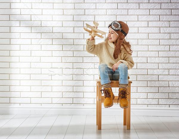 Menina jogar brinquedo avião feliz criança Foto stock © choreograph