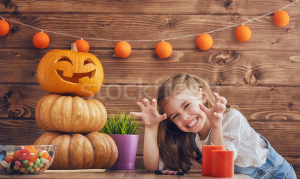 Fille citrouille heureux halloween cute peu Photo stock © choreograph