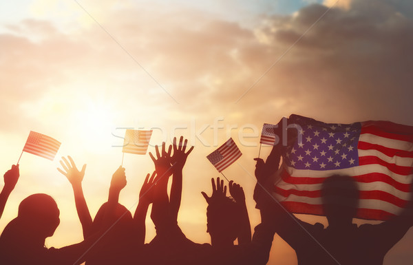people holding the Flag of USA Stock photo © choreograph