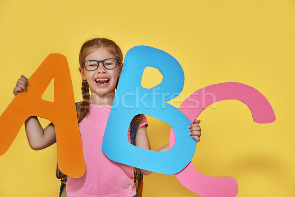 child with big letters Stock photo © choreograph