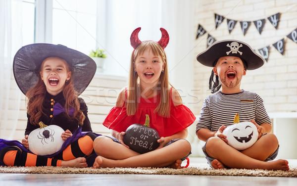 children play with pumpkins Stock photo © choreograph