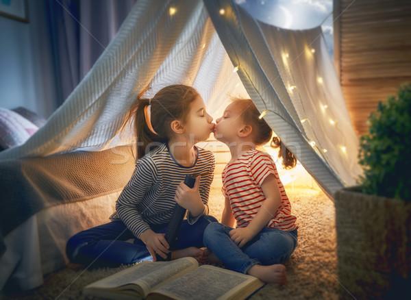 children are reading a book Stock photo © choreograph