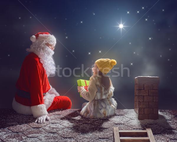 Ragazza babbo natale seduta tetto allegro Natale Foto d'archivio © choreograph