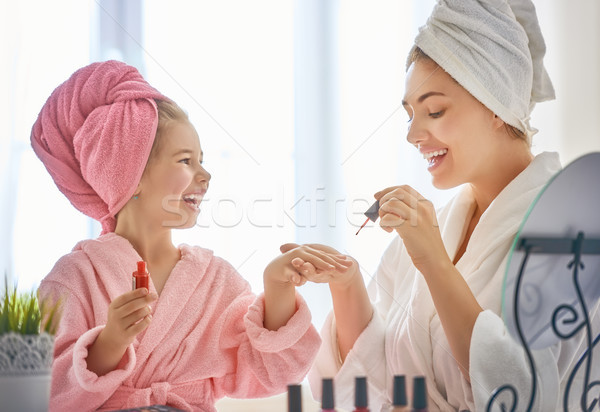 Mother and daughter are doing manicures Stock photo © choreograph