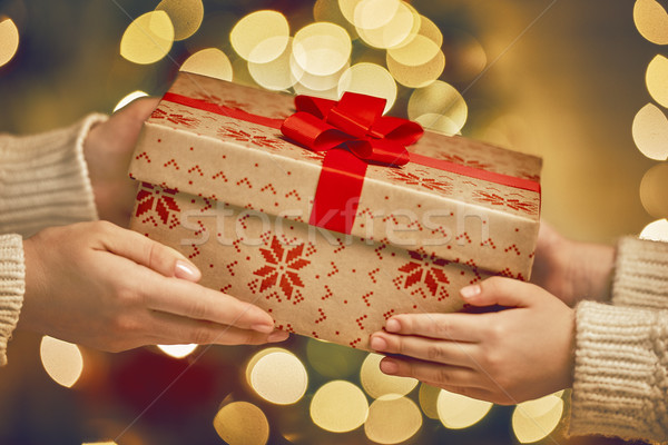 Hands giving x-mas gift Stock photo © choreograph