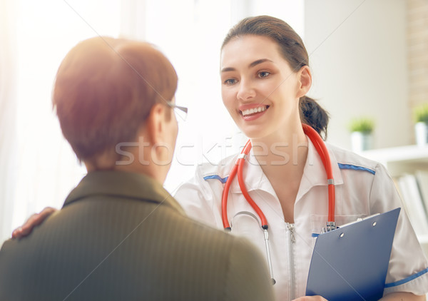 Female patient listening to doctor Stock photo © choreograph