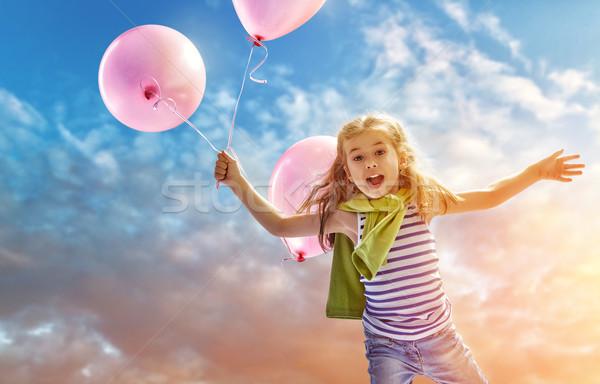 Meisje roze ballonnen hemel Stockfoto © choreograph