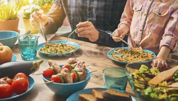 Genießen Familie Abendessen zusammen Sitzung rustikal Stock foto © choreograph