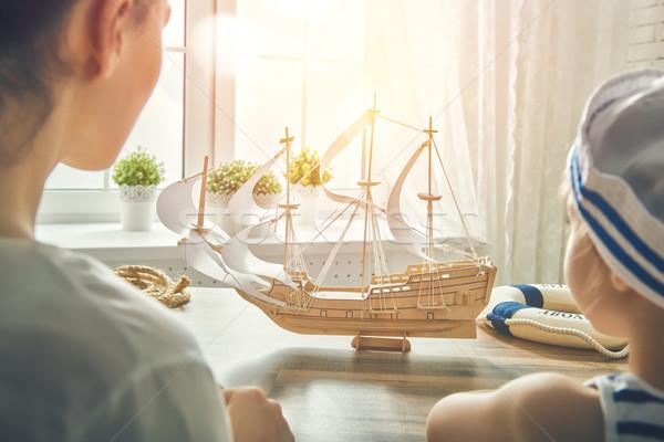 child making model ship Stock photo © choreograph