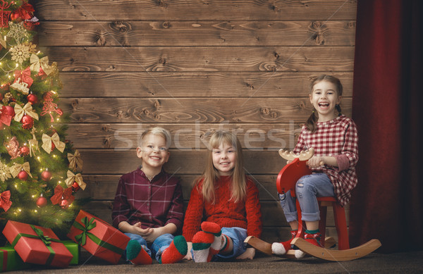 children on wooden background Stock photo © choreograph