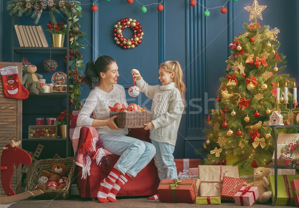 Mom and daughter decorate the tree Stock photo © choreograph