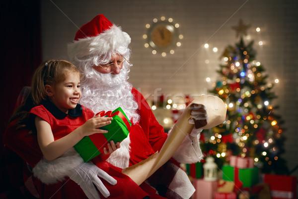 Stockfoto: Kerstman · aanwezig · weinig · cute · meisje · huis