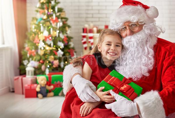 Santa Claus and little girl Stock photo © choreograph
