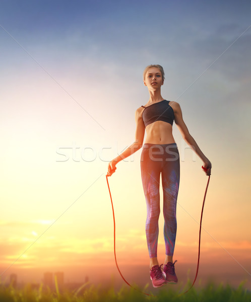 Woman with skipping rope. Stock photo © choreograph