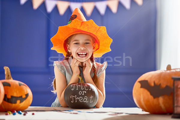 girl with carving pumpkin Stock photo © choreograph