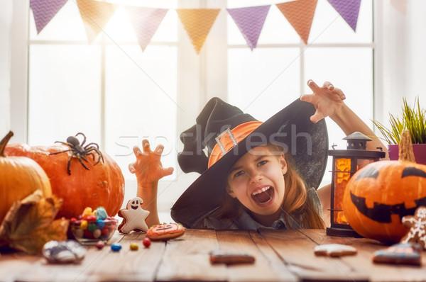 girl with carving pumpkin Stock photo © choreograph
