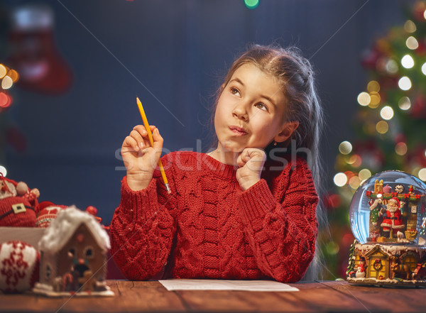 girl is writing the letter to Santa Stock photo © choreograph
