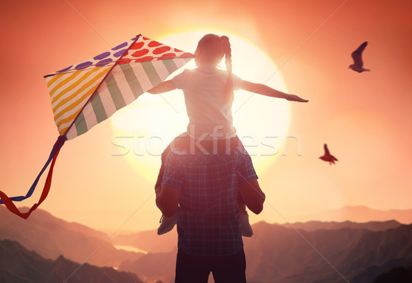 Father and daughter with kite Stock photo © choreograph