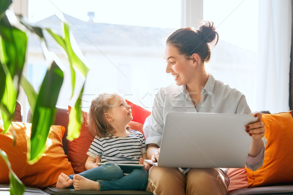 mom and child with laptop Stock photo © choreograph