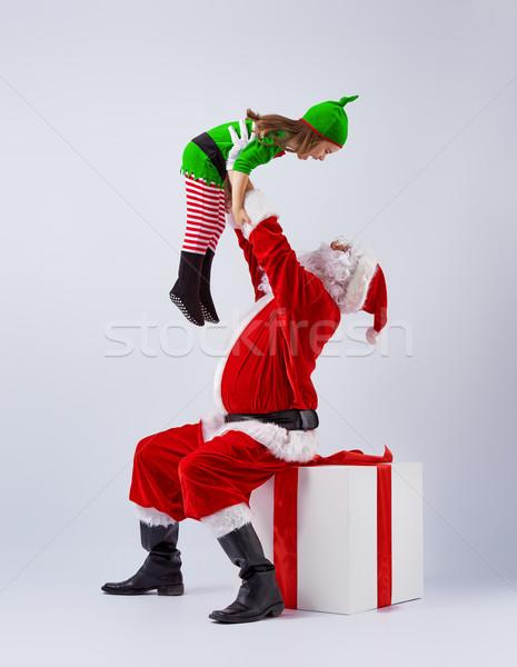 Papá noel alegre elfo jugar junto nino Foto stock © choreograph