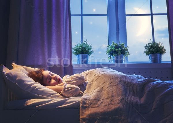 girl sleeping in the bed Stock photo © choreograph