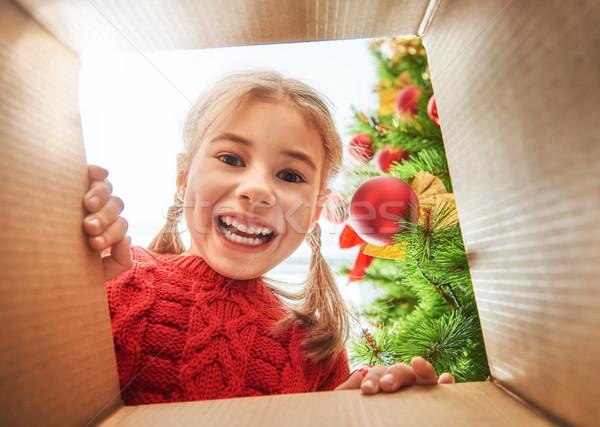 girl opening a Christmas present Stock photo © choreograph