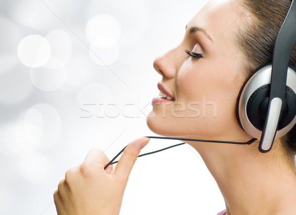 Nina auriculares blanco música tecnología diversión Foto stock © choreograph