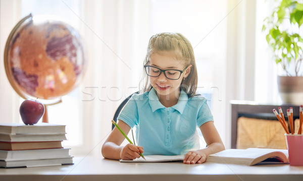 child is sitting at a desk indoors Stock photo © choreograph