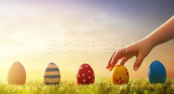 child hunts for Easter eggs Stock photo © choreograph