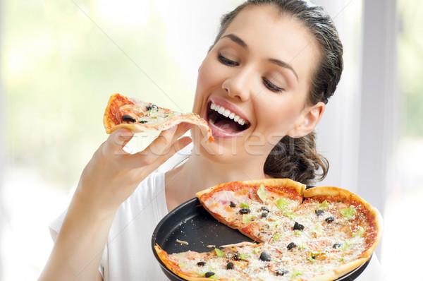 Heerlijk pizza meisje eten vrouw glimlach Stockfoto © choreograph