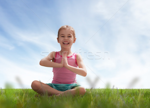 child practicing yoga Stock photo © choreograph