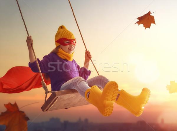 Criança balançar feliz pôr do sol cair pequeno Foto stock © choreograph