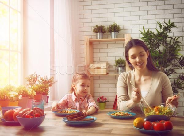 enjoying family dinner Stock photo © choreograph