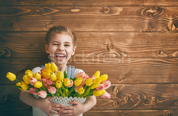 girl with a bouquet of tulips Stock photo © choreograph