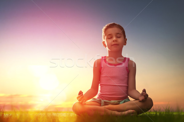 Girl is practicing yoga Stock photo © choreograph
