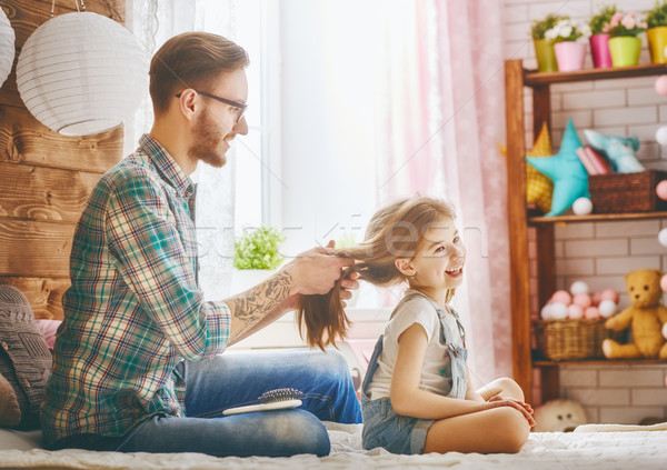 Father is combing her daughter Stock photo © choreograph