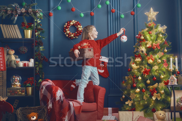 girl is decorating the Christmas tree Stock photo © choreograph
