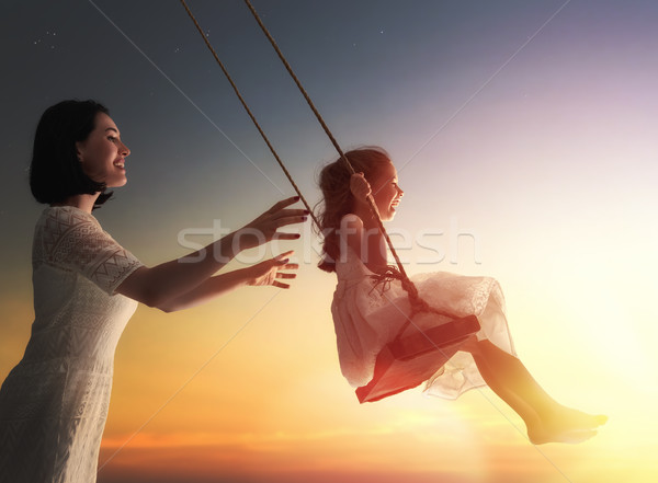 mother and  daughter swinging on swings Stock photo © choreograph
