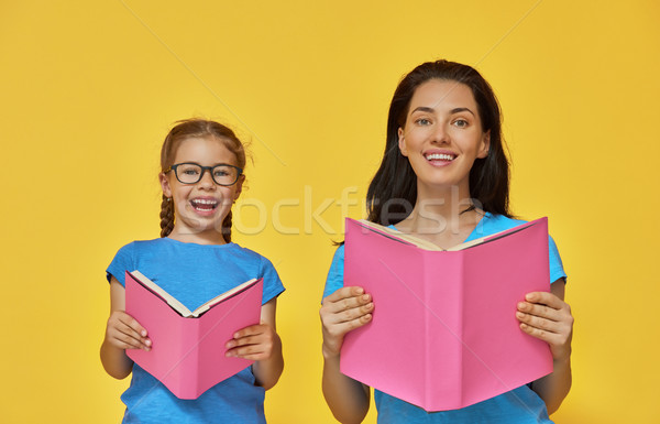 child and mother are reading the books Stock photo © choreograph